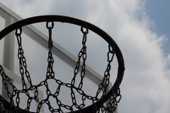 Basketball goal, Hoop and Net, goal. Basketball goal, Hoop and Net on nice blue background, chains instead of ropes, dark style stock photography