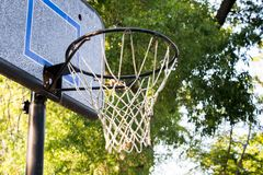 Outdoor basketball goal and net. Basketball goal in neighborhood. Backboard and net ready for pickup game stock images