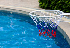 Basketball goal at the poolside Stock Photos