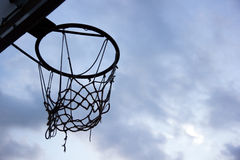 Basketball goal. Silhouette of a basketball ring and net on sky. Background with copy space. Sport backdrop stock image