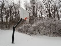 Basketball goal winter snow. Cold stock images