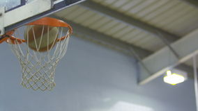 Basketball goes through the hoop in slow motion stock video