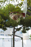 Basketball going through a hoop in a city park basketball court Stock Photo