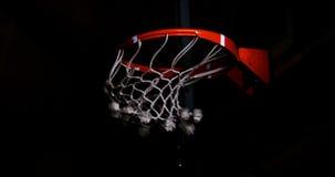 Basketball going through hoop stock video footage