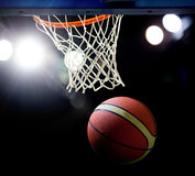 Basketball going through the hoop Royalty Free Stock Image