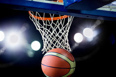 Basketball going through the hoop Royalty Free Stock Photo