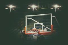 Basketball going through net and scoring during match ,Blurry an. D soft focus Stock Photography