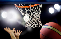 Basketball Going Through The Hoop Stock Image