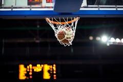 Basketball Going Through The Hoop Royalty Free Stock Photos