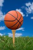Basketball on golf tee royalty free stock photography