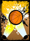 Basketball on grunge. In flashlights Stock Photography