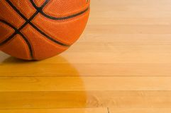 Basketball on gym floor Stock Images