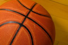 Basketball on gym floor Royalty Free Stock Photos