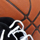 Basketball and gym shoes Royalty Free Stock Images