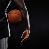 Basketball in hand of a young player Stock Photo