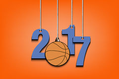 Basketball  and 2017 hanging on strings. New Year numbers 2017 and basketball as a Christmas decorations hanging on strings. Vector illustration Royalty Free Stock Images