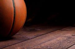 Basketball on hardcourt Stock Images