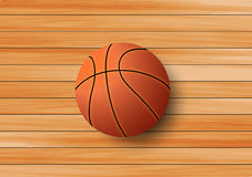 Basketball on the hardwood floor background Royalty Free Stock Photos