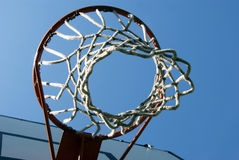 Basketball hoop. A basketball hoop with net against blue sky royalty free stock photo