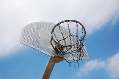 Basketball hoop. Against blue sky background royalty free stock photo