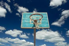 Basketball hoop. And net against blue sky and clouds. Horizontal view royalty free stock photo