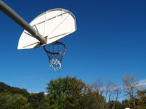Basketball Hoop. A basketball hoop extending out into a bright blue sky Royalty Free Stock Photo