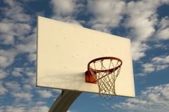 Basketball Hoop. And backboard with blue sky and clouds in background Stock Images