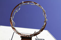 Basketball hoop. A basketball hoop with blue sky above Royalty Free Stock Photo