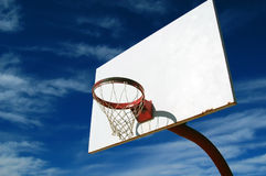 Basketball Hoop. Isolated shot of basketball hoop and rim against a blue sky Royalty Free Stock Photo