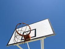 Basketball hoop. On an outdoors court. Clear sky on a sunny day Royalty Free Stock Image