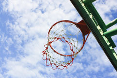 Basketball hoop. Outdoor basketball hoop and blue sky royalty free stock images