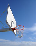 Basketball Hoop. New basketball hoop against blue sky Royalty Free Stock Photography
