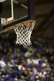 Basketball Hoop. A basketball hoop with fans in the background Royalty Free Stock Image