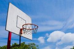 Basketball hoop. Outdoors basketball hoop on blue sky background Royalty Free Stock Photo