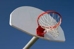 Basketball hoop. School yard basketball hoop with sky Stock Photo