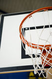 Basketball hoop. A basketball hoop in an International sport venue. Possible venue for the 2016 Olympic Games. Shallow DOF stock photo