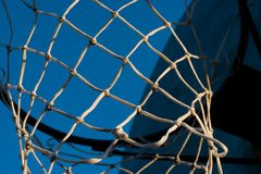 Basketball Hoop. A rusty old basketball hoop against a blue sky in the evening Stock Image