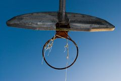 Basketball Hoop. A rusty old basketball hoop against a blue sky in the evening Stock Photo