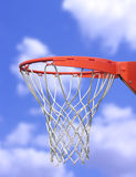 Basketball Hoop. A photo of a basketball hoop with the sky in the background Stock Photo