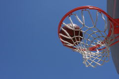 Basketball in the hoop Royalty Free Stock Photos