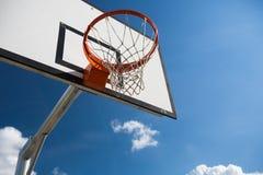 Basketball hoop against  lovely blue summer Royalty Free Stock Photos