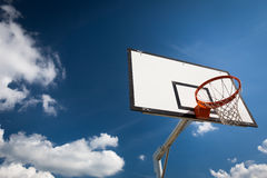 Basketball hoop against  lovely blue summer Royalty Free Stock Photography