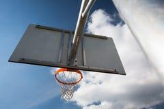 Basketball hoop against  lovely blue summer Stock Images