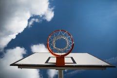 Basketball hoop against  lovely blue summer Stock Photos