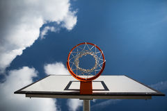 Basketball hoop against  lovely blue summer Royalty Free Stock Images