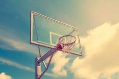 Basketball hoop against sky background Stock Photos