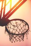Basketball hoop on amateur outdoor basketball court. For streetball, against strong summer sunlight stock photos