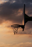Basketball hoop and backboard. Against cloudy sky Royalty Free Stock Photo
