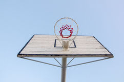 Basketball hoop and backboard. Basketball hoop from below and sky as background Royalty Free Stock Photo