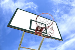 Basketball Hoop. And backboard blue sky in background stock photo